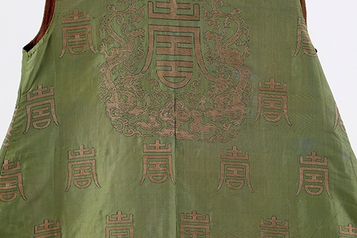 Auspicious Robe with multiple Shou (longevity) characters. China, Qianlong period (1736-1795). Silk and gold brocade. 53 x 47 inches (134.6 x 119.4)